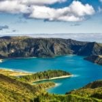 Stunning picture of a blue lake surrounded by mountains in The Azores taken from above.