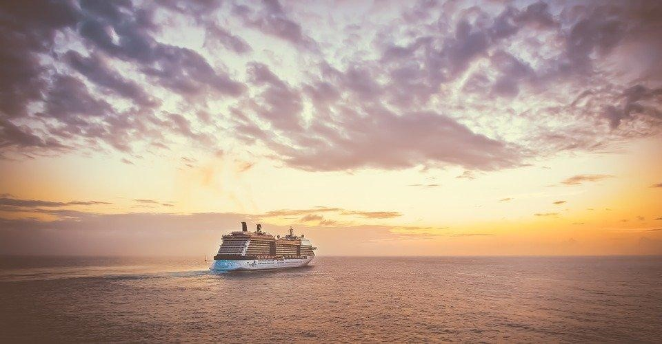 A cruise ship sailing into the sunset